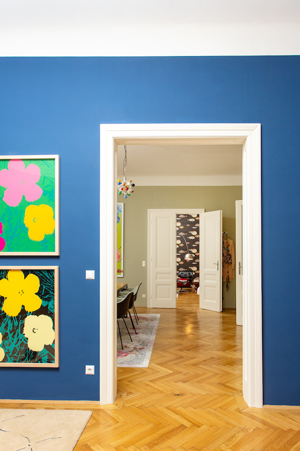 Andy Warhol's Flowers series (partial) on a blue wall. Courtesy of Nina Gscheider and Franz Ihm.