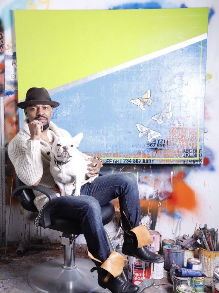Guy Stanley Philoche with his dog Picasso in his studio. Courtesy of Guy Stanley Philoche.