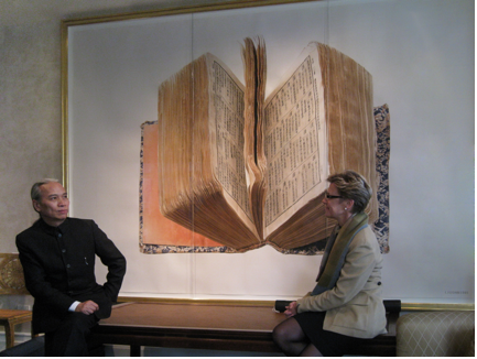 Liu Dan in conversation with Jane DeBevoise, Chair of the Board of Directors of Asia Art Archive in Hong Kong and New York, in front of The Dictionary, 81 x 121 inches, watercolor on paper, 1991. Photo: Asia Art Archive.