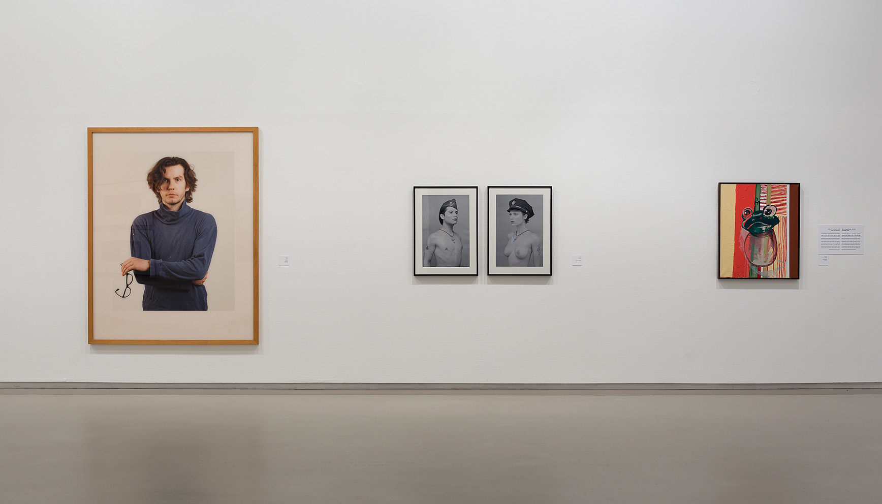 "Installation view from the exhibition ""Prima Facie"", Tel Aviv, 2016. From Left to right: Thomas Ruff, Self Portrait, 1987. Nir Hod, Policeman and policewoman, 1997. Martin Kippenberger, Untitled (from the series the Egg-Paintings), 1996. Courtesy of Igal Ahouvi Art Collection."