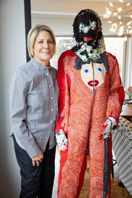 Eileen next to an artwork - Raul de Nieves, Celebratory Skin - Blue God, 2016. Courtesy of Eileen and Richard Ekstract.