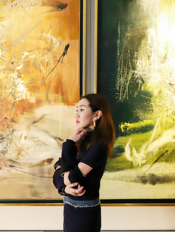 Sabrina Ho with two works by Zao Wou-ki. On the left is 16.5.66 (1966) and on the right 3.4.60-1.2.69 (1960-69). Courtesy of Sabrina Ho.