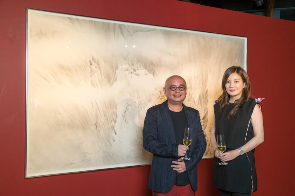 Artist Cai Xiaosong with actress Zhao Wei.